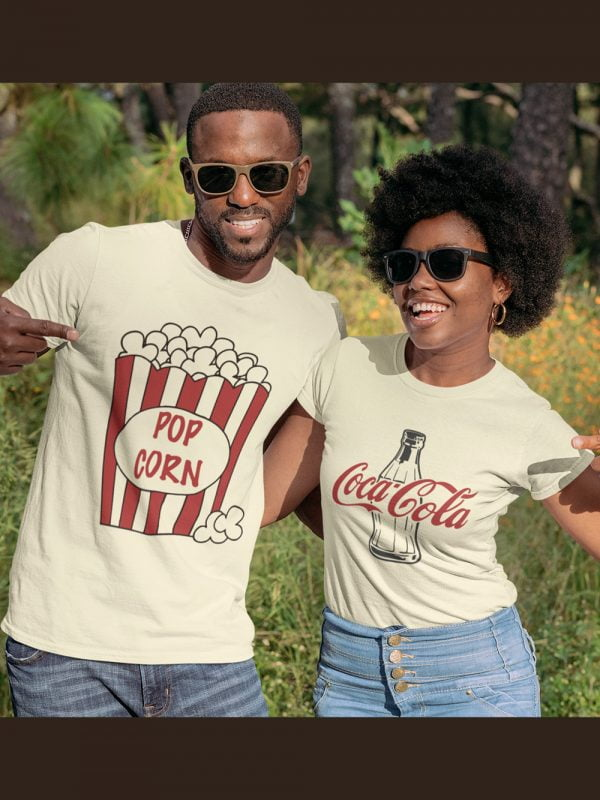 man and woman wearing popcorn and cola couple t-shirt , pointing at the t-shirt and smiling