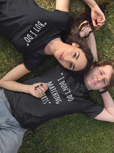 "man and woman leaning against the wall wearing ""i don't do matching t-shirts"""