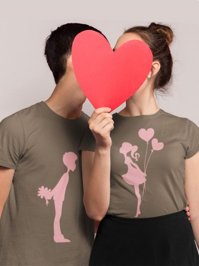 man and woman sharing a kiss with faces behind paper heart wearing Kissing Couple T-shirt