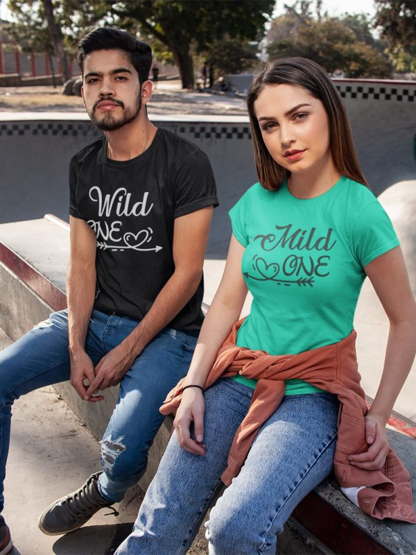 man and woman sitting in style wearing mild one wild one couple t-shirt