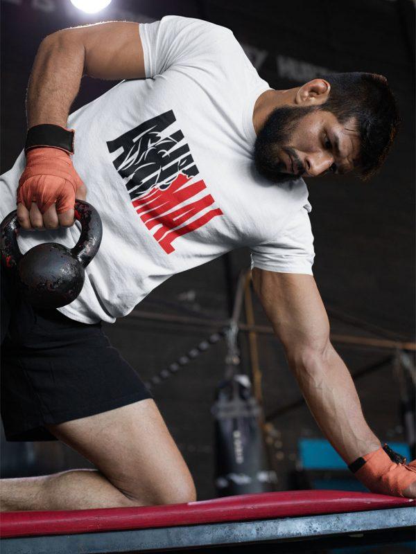 man wearing Animal T-shirt and lifting weights