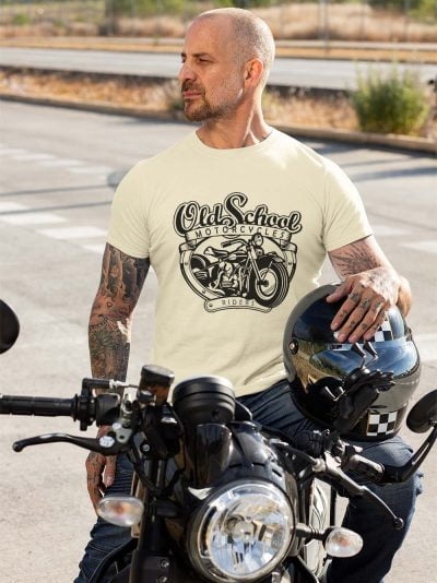 Man wearing Old School Motorcycle T-shirts sitting on a bike.