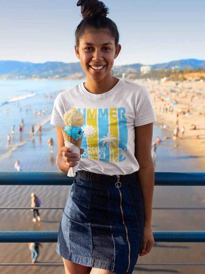 Girl wearing Summer Beach T-shirt standing at the beach.