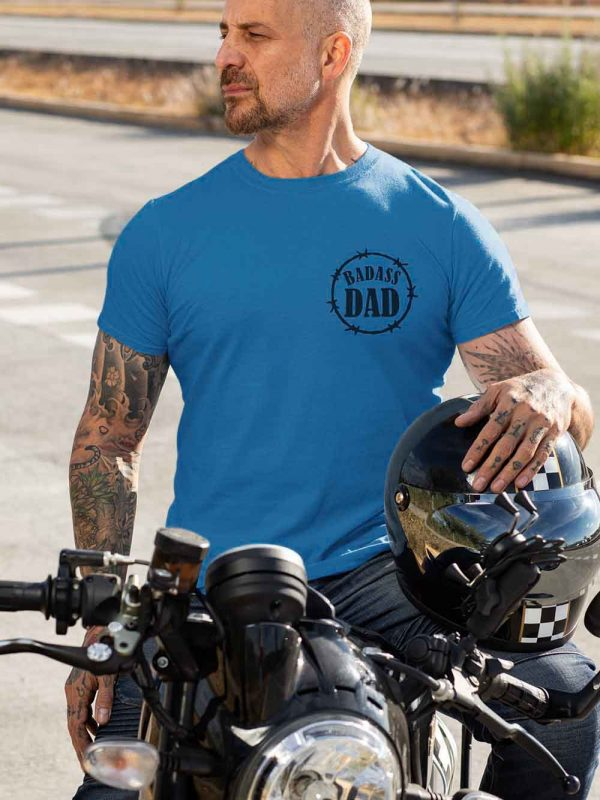 Man wearing Bad Ass Dad T-shirt sitting on a motorcycle