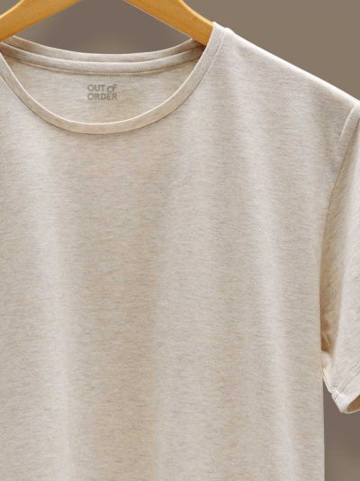 cream color t-shirt for men zoomed on a wooden hangar