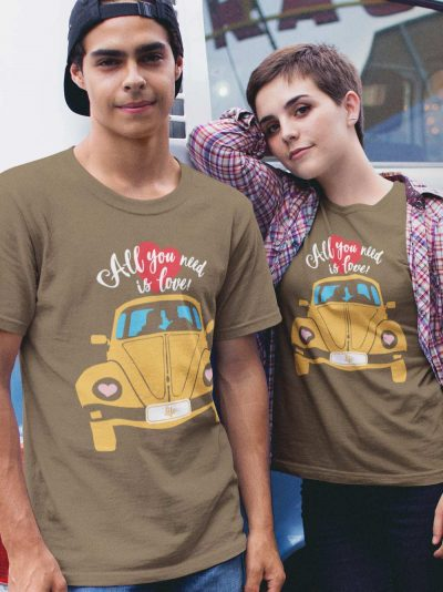 Couple wearing All I Need is Love Couple T-shirt for sale