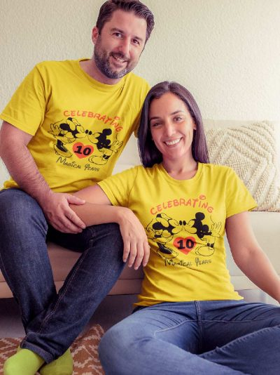 Couple wearing Mickey Minnie Anniversary T-shirt available for sale