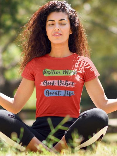 meditating woman wearing Positive Mind Women's Yoga T-shirt, available for sale